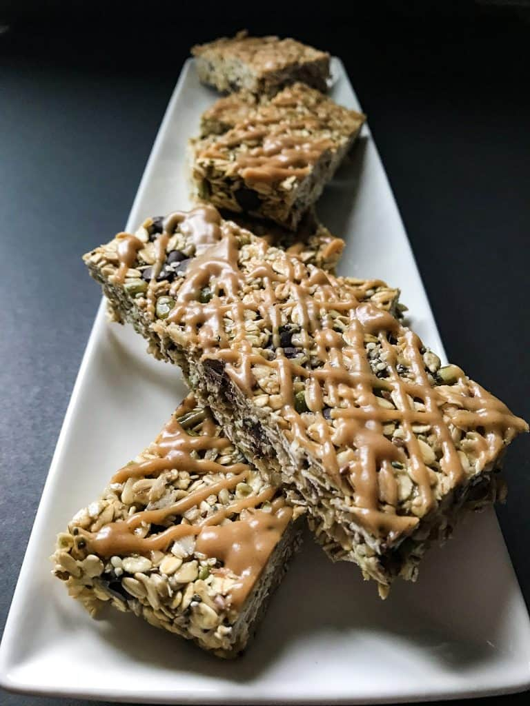 Chewy Granola Bars side view on a thin white plate