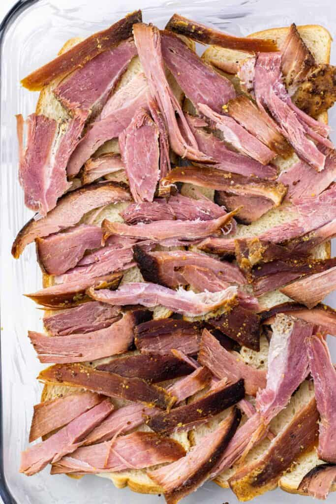spreading the shredded ham onto the bread layer