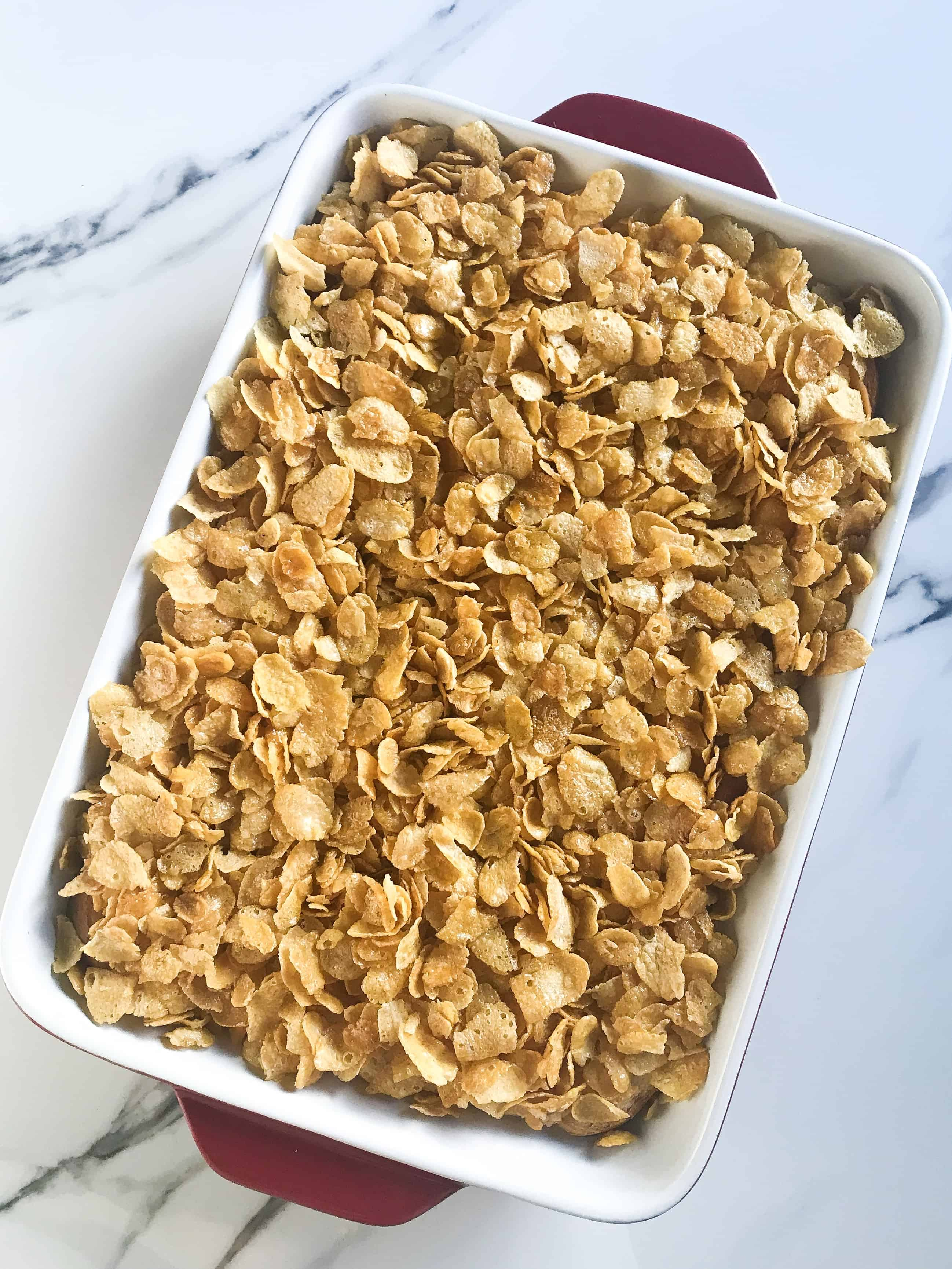 casserole topped with cornflakes ready to be baked