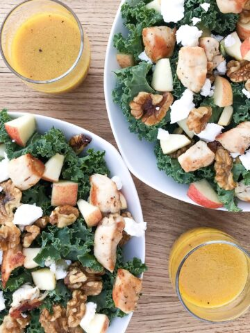 kale apple salad with crumbled goat cheese, maple candied walnuts, apple, chicken, and honey mustard vinaigrette on the side