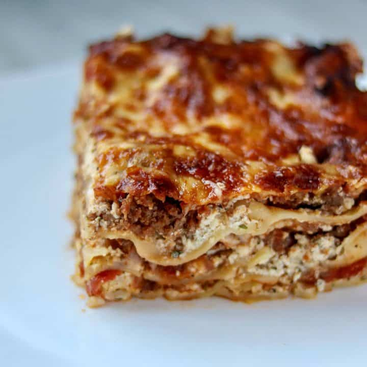 a slice of lasagna on a white plate