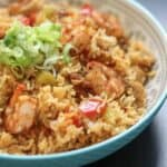 side view of jambalaya in a blue bowl