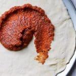 pizza sauce glob swirled on pizza crust