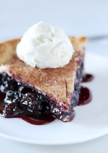 slice of cherry rum pie with vanilla bean ice cream on top