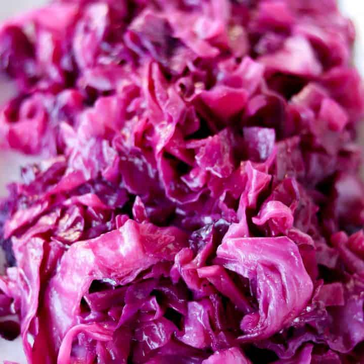 side angle picture of cabbage on a white serving plate