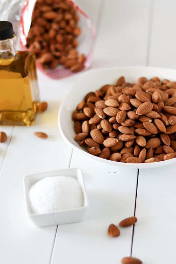 all of the ingredients you need to make roasted almonds laid out