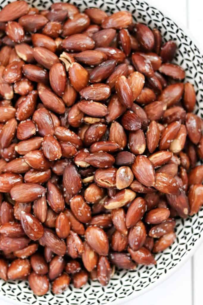 close up of a bowl of roasted almonds