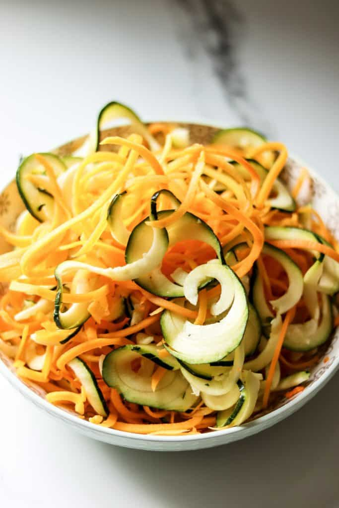 bowl full of spiralized butternut squash and zucchini