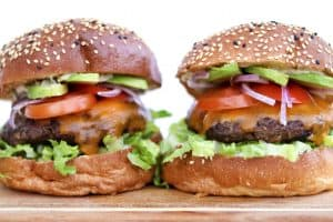 two burgers standing tall side by side