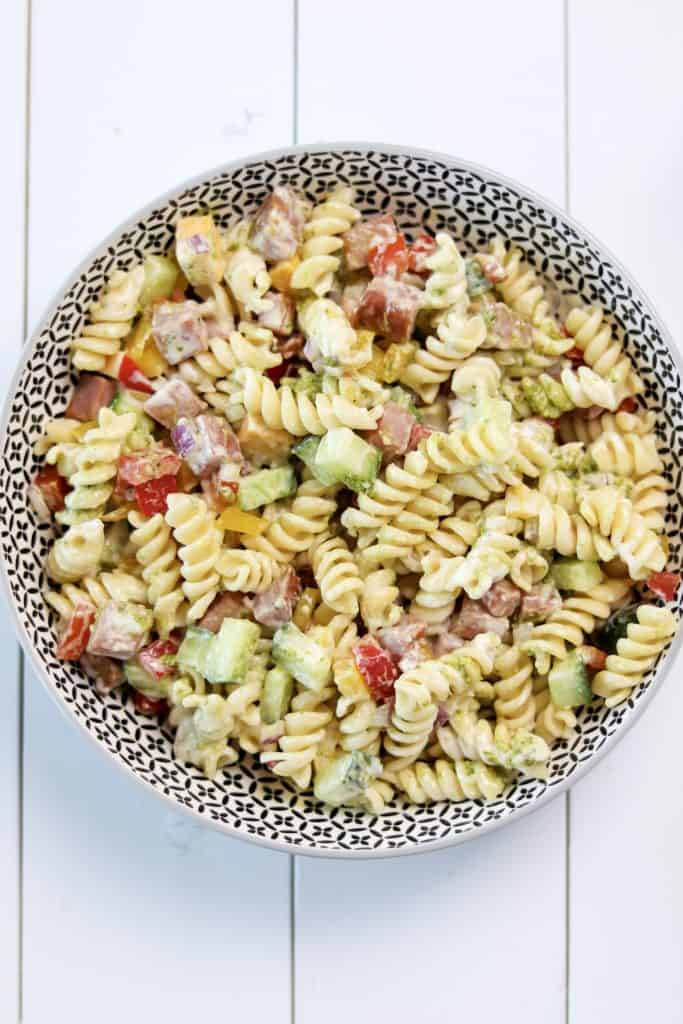 easy pasta salad tossed with basil pesto and caeser dressing