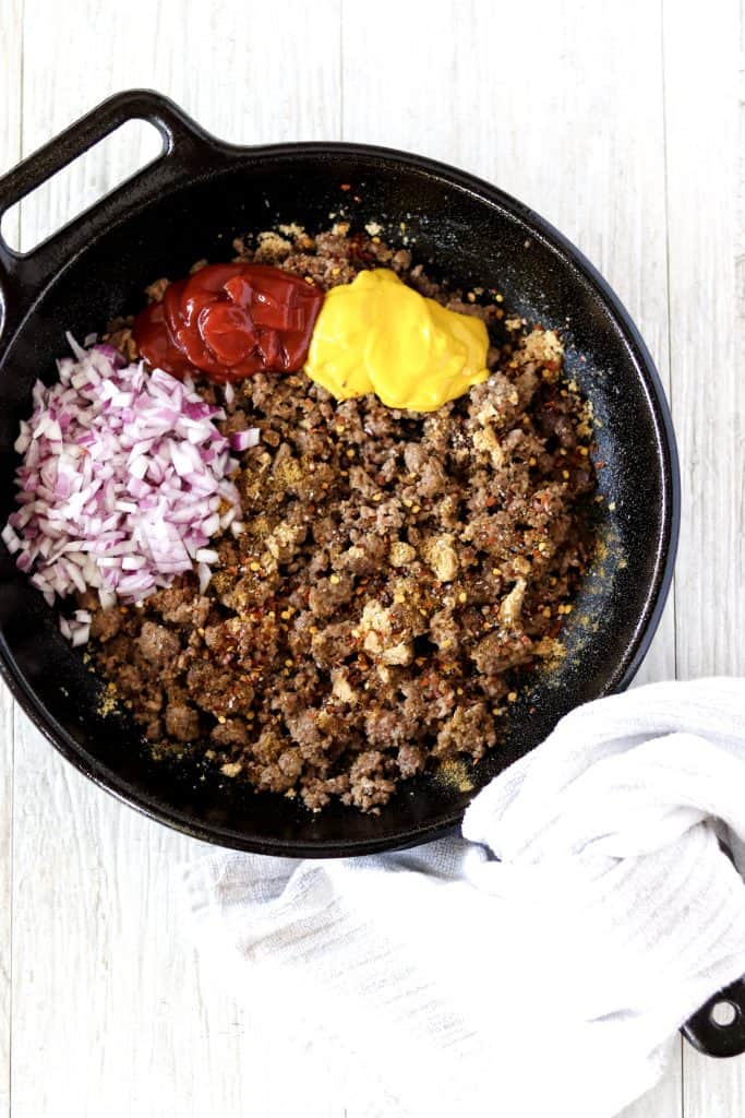 all of the hamburger filling ingredients in a cast iron pan