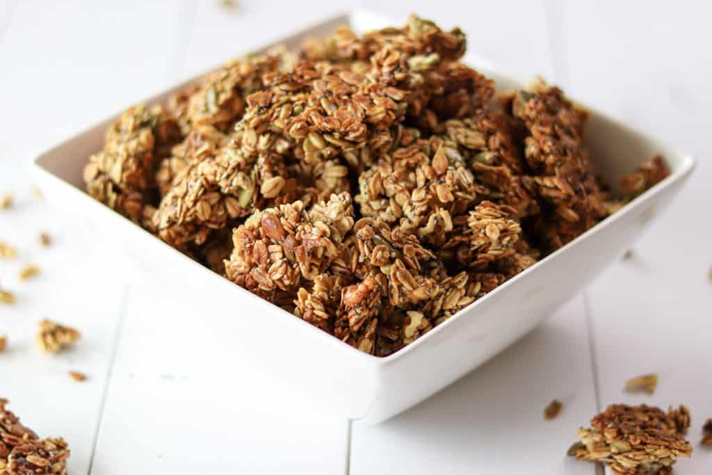 baked granola broken up and piled in a bowl