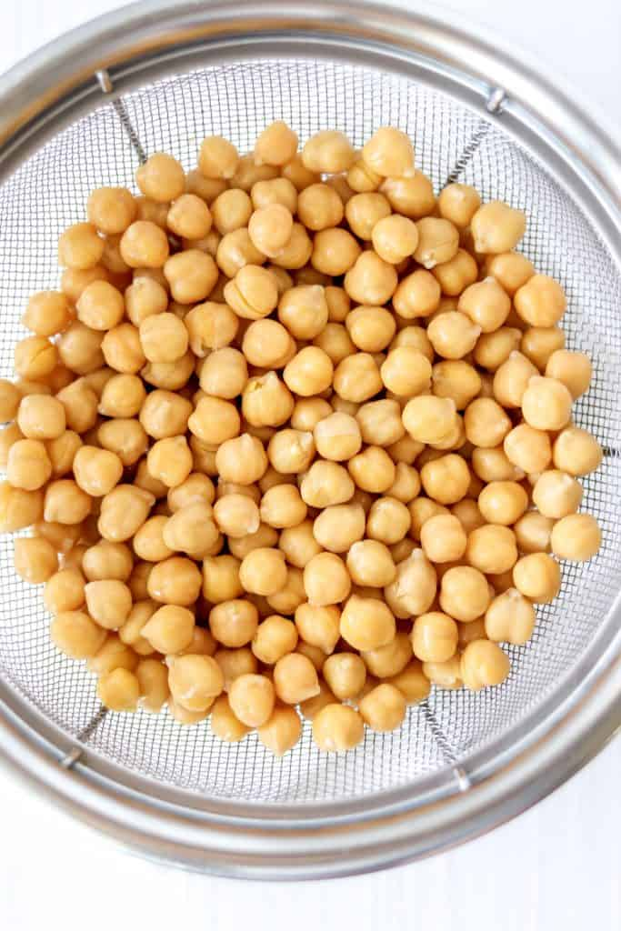 chickpeas being drained for the hummus
