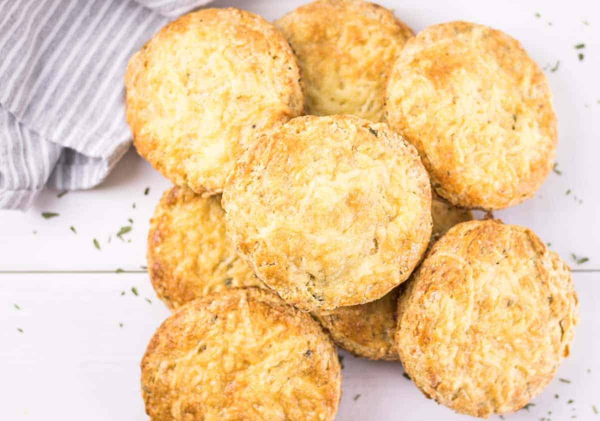 a large pile of baked Cheddar Tarragon Buttermilk Biscuits