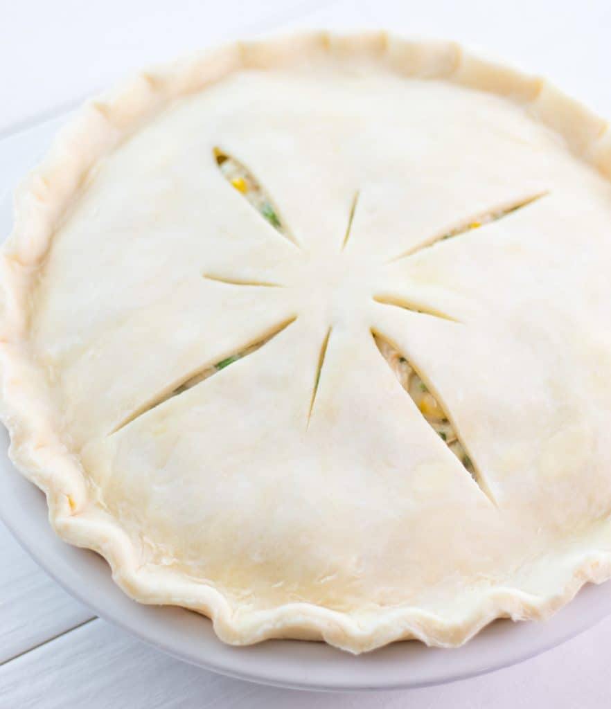 chicken pot pie with the edges of the crust crimped and ready to be frozen or baked.