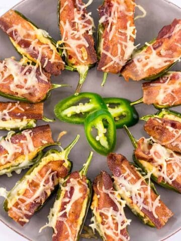 a plate full of Smoked Cheddar and Bacon Jalapeno Poppers