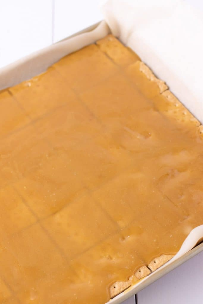 caramel evenly spread over top of the crackers