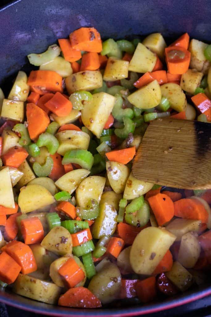 sautéing the vegetables in garlic