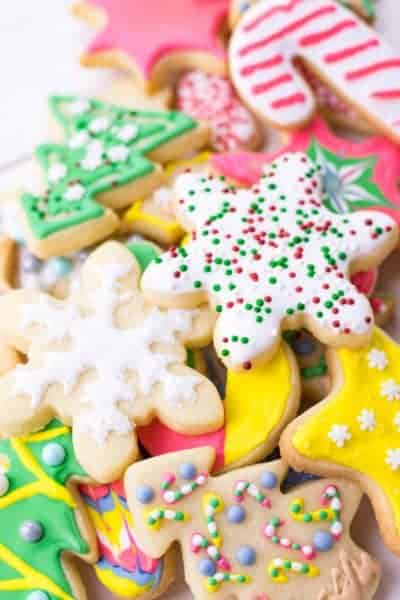 a pile of decorated sugar cookies