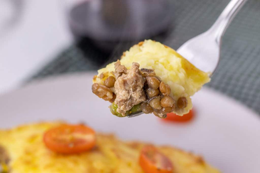 close up of a bite of turkey shepards pie on a fork