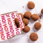 chocolate truffles spilling out of a holiday gift box
