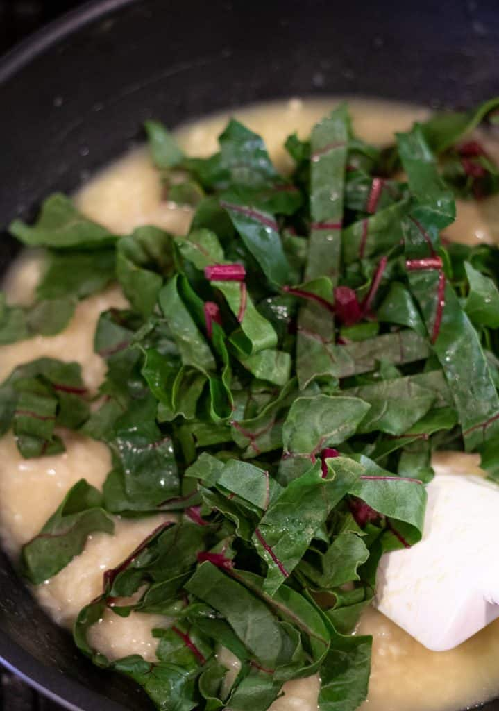 adding the swiss chard into the risotto