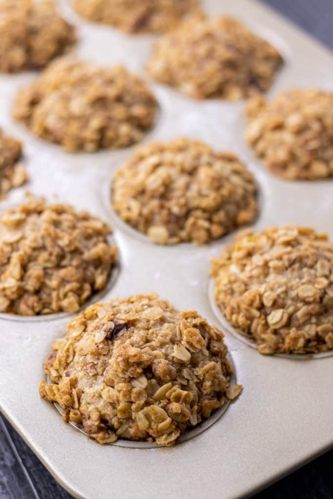 banana oat muffins straight out of the oven in the muffin tin