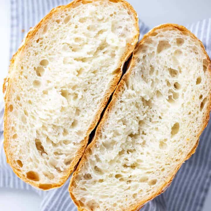 a completed loaf of no knead bread cut in half