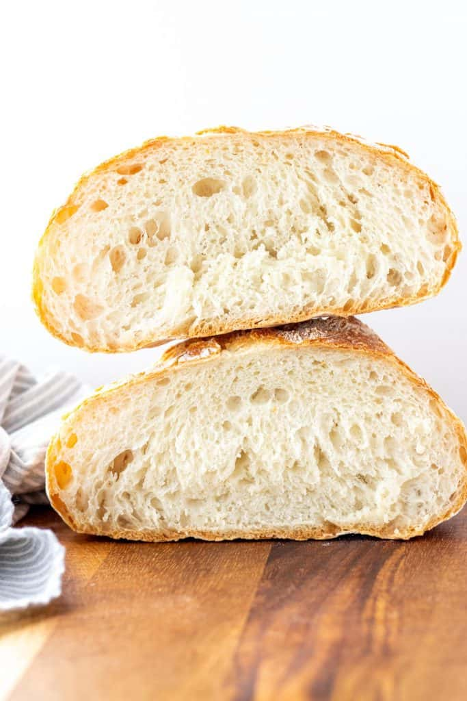 A loaf of No Knead Bread cut in half and stacked on top of each other