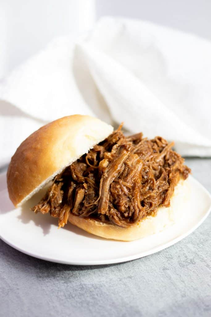 Slow Cooker BBQ Pulled Pork sandwich on a white plate