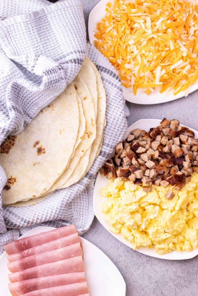 all of the ingredients prepped and laid out, ready to assemble the breakfast enchiladas