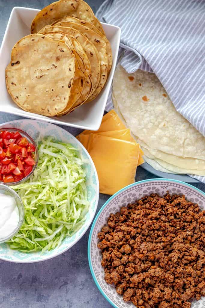 all of the ingredients needed to make the crunchwrap supreme