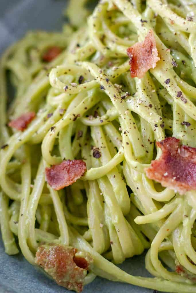 a close up of the creamy avocado carbonara in a serving dish