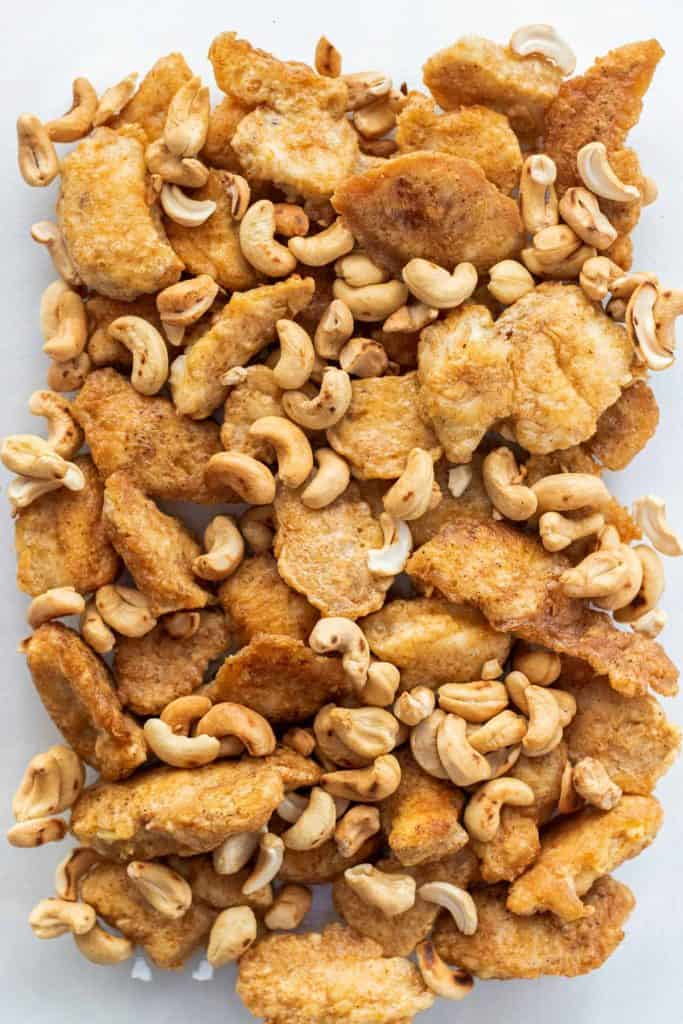 Adding the toasted cashews in with the chicken