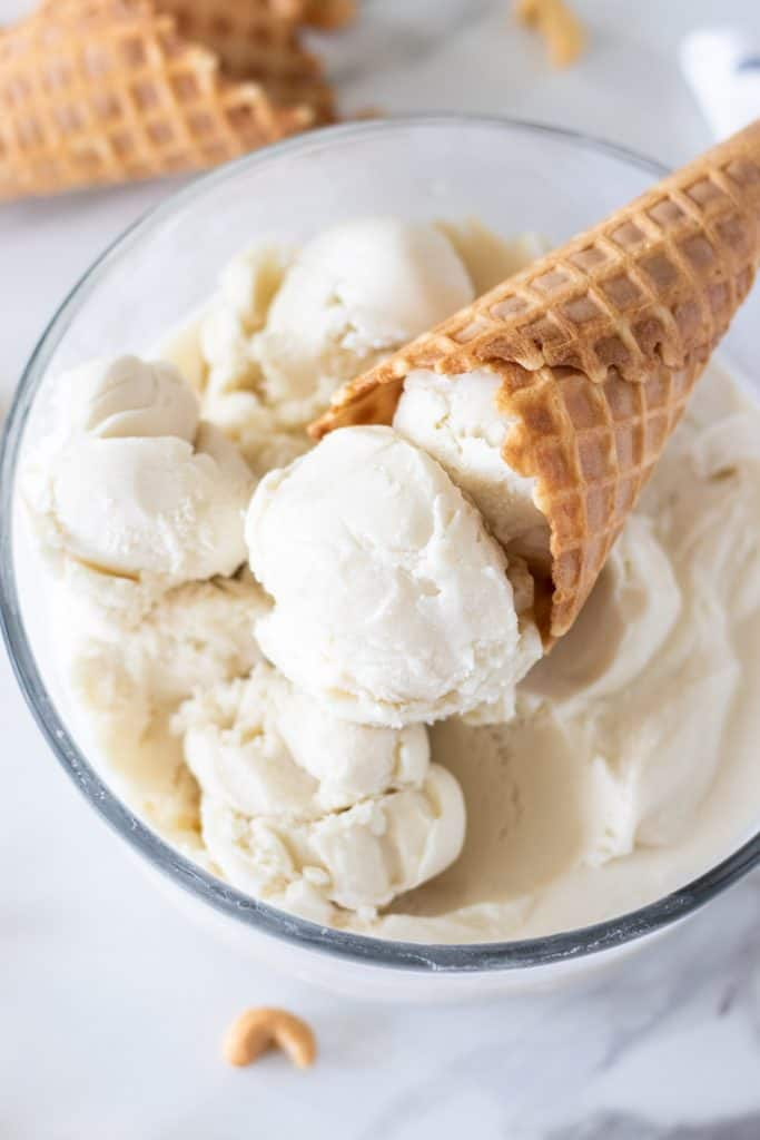 a scoop of ice cream in a waffle cone