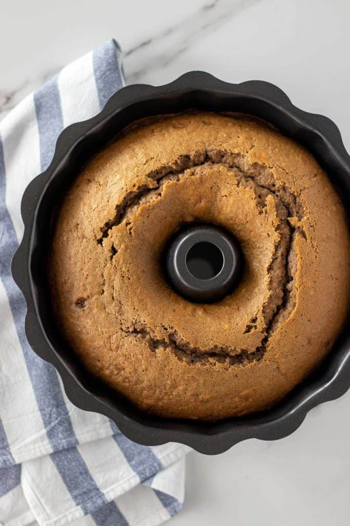 a photo showing the dalgona coffee cake in the bundt pan, right after it was baked