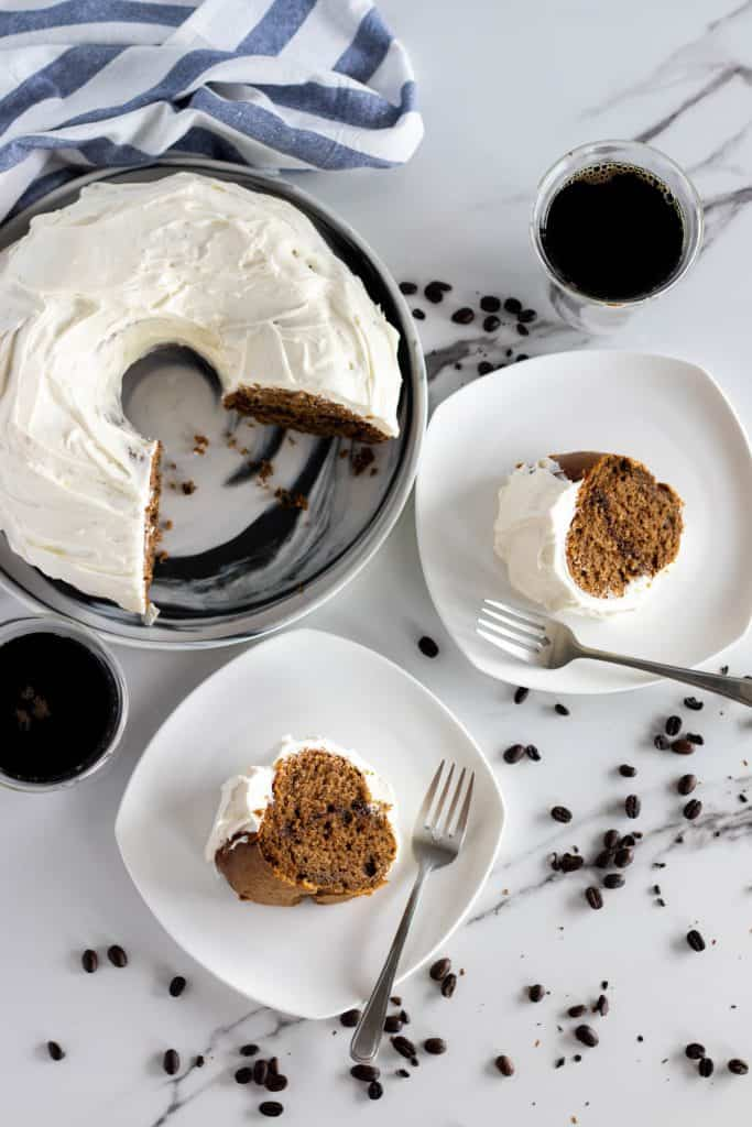 two slices of cake served with freshly brewed coffee