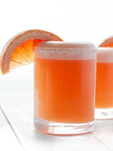a blended grapfruit paloma with a wedge of grapefruit on the rim