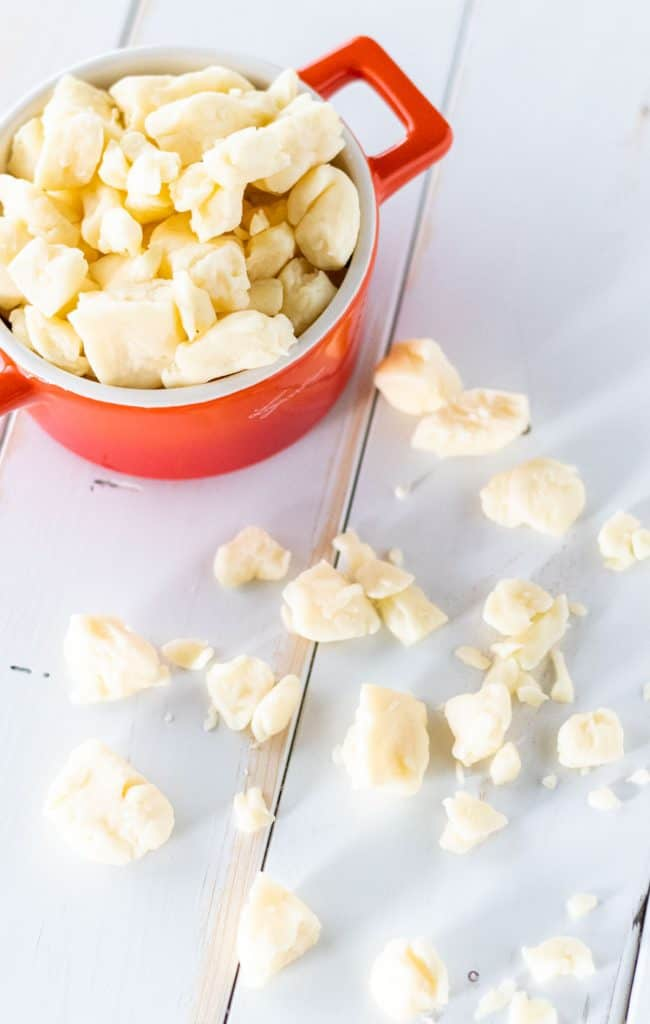 a bowl of cheese curds overflowing to make authentic Canadian poutine
