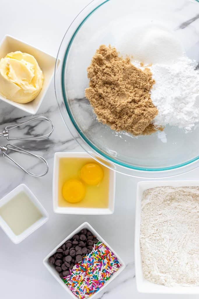 all of the ingredients to make chocolate chip funfetti cookies