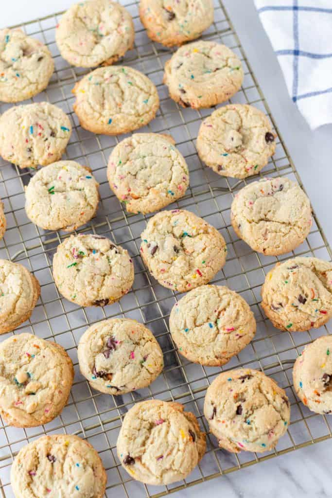 baked Chocolate Chip Funfetti Cookies on a cooling rack