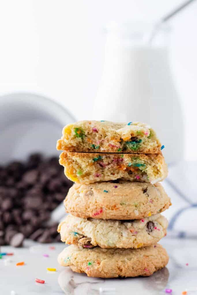 a stack of Chocolate Chip Funfetti Cookies with one broken in half so you can see the inside