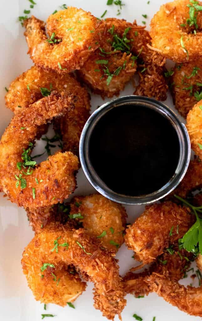 coconut shrimp fried to a delicious golden brown and served with a side of honey soy dipping sauce