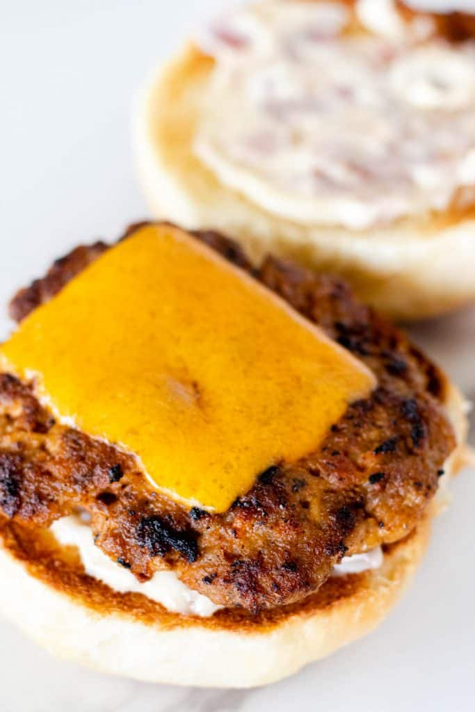 placing a chorizo patty on the slider bun