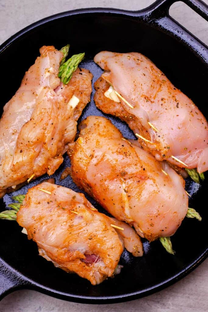 searing the chicken in a cast iron pan.