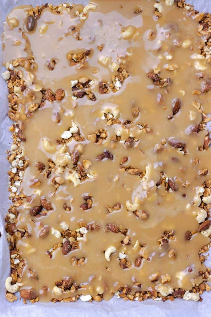 all of the buttercrunch toffee poured onto the nuts