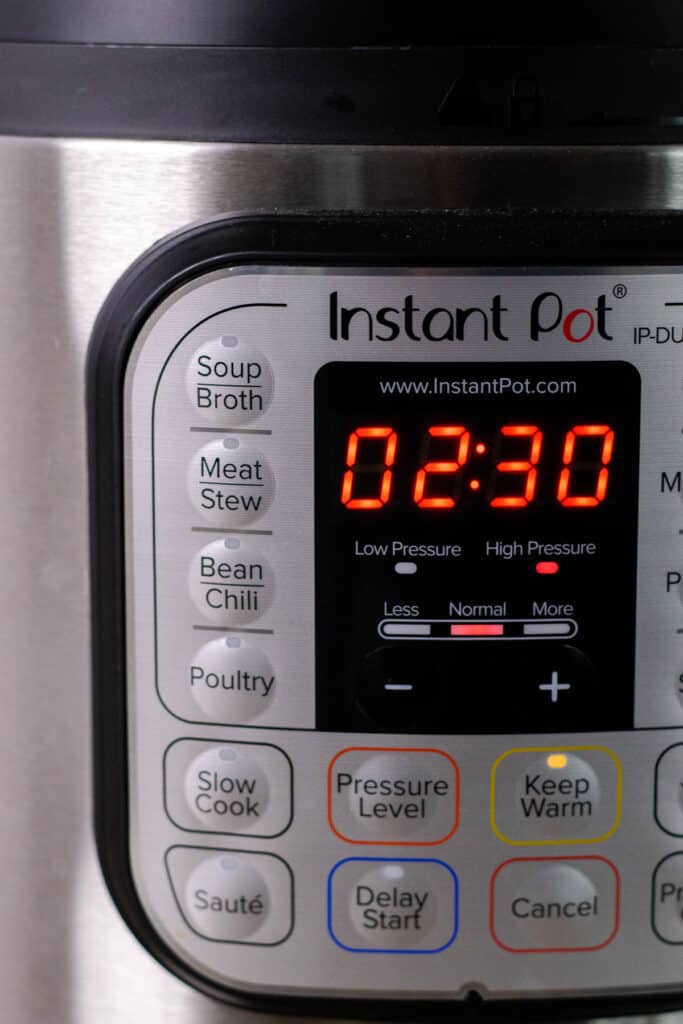 setting the timer on the pressure cooker for two and a half hours