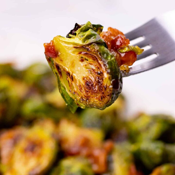 a brussel sprout with spicy bacon jam on a fork