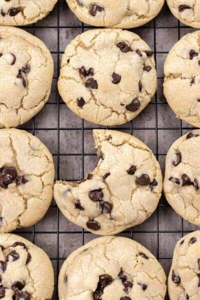 one chocolate chip cookie with a bite out of it