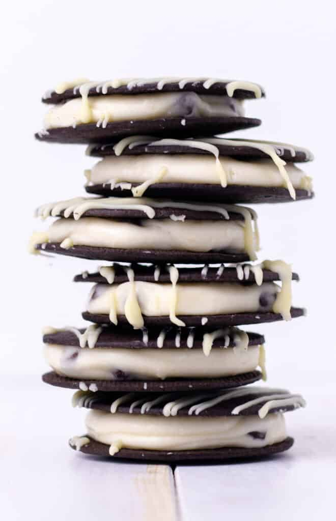 a stack of chocolate cream cookies